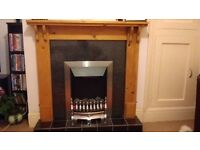 Wooden fire surround and electric fire