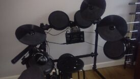 electric drum kit and pioneer headphones