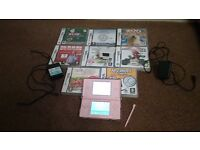 Pink Nintendo DS Lite with 8 Games (1 Games is still sealed)