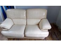 Two seater sofa, John Lewis made, has some scratches on the side (cat) see pictures. Beige colour.