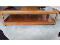 Glass and wood topped coffee table with wooden base