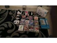 Wii console and 14 games