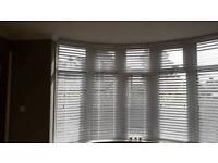 Pair of brand new vertical white blinds