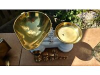 Old style brass and white cast metal kitchen scales