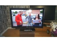 """40"""" Samsung TV with remote control and stand"""