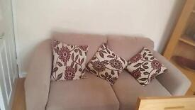 Two seater sofa with scatter cushions