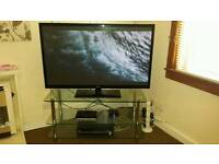 "Solid heavy glass TV stand!! Excellent condition!! Fits upto 50"" TV!! Can deliver if needed!!"