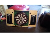 Dartboard in wooden case, good condition, not used anymore