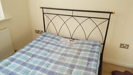 Black metal frame double bed and slumberland mattress