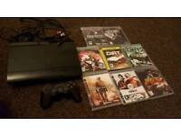 Ps3 slim console with 1 control and 8 games
