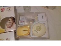 Medela swing electric breast pump and Tommy Tippee hand held breast pump