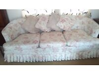 elegant 3 seater low curved settee with extra set covers