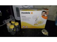 Used but still full of life Medela swing Breast Pump with extras