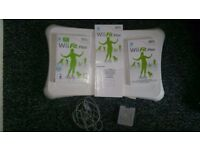 Nintendo wii fit board with CD and battery with charger