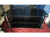 large toghend glass tv stand delivery available