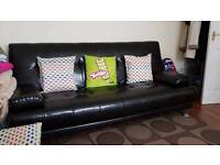 Black faux leather sofa bed 3 seater with 2 cushions excellent condition no damages