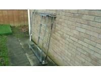 Universal ladder side loading roof rack including pipe tube mounts