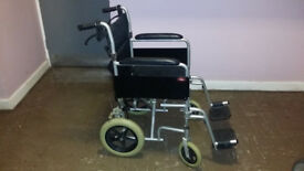 'Enigma' lightweight aluminium transit wheelchair. with seatbelt