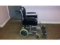 'Enigma' lightweight aluminium transit wheelchair. with seatbelt