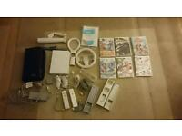 Nintendo wii with 58 games and accessories.