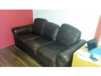 sofa three seater brown leather comfy free to a good home:)