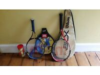 2 small tennis rackets with matching cases, plus a pack of 3 tennis balls.