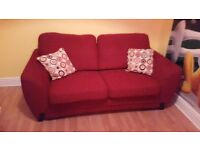 **MUST GO - RED SPRING ACTION SOFA BED**