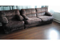 large sofa bed and two armchairs