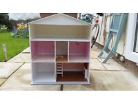 Wooden doll's house in good basic condition and in need of some refurbishment
