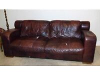 Sofa-brown leather effect.Couple small tears