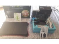 Black wii and wii fit plus with balance board in there boxes