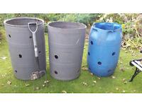 Three number plastic compost bins.
