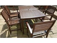 Wooden patio set with 6 chairs and large parasol