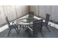 Garden table and 6 chairs. Option on buying chairs and table separately. Collection only.