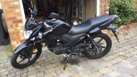 Yamah YS125 motorbike