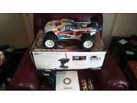 BNIB. HELION BRUSHLESS RC TRUGGY. NEVER BEEN USED JUST TESTED IN HOUSE. REALLY CHEAP PRICE.