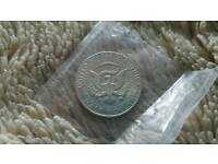 2 1960s silver Kennedy half dollars