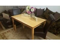 Solid wood dining table and 2 leather chairs