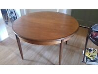 g plan dining table with four chairs