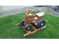 Solid wood rocking tractor