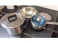 Assorted pots and kitchenware (utensils, colander, grater)