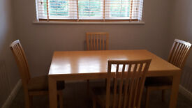 Solid maple dining room table with matching chairs (4)