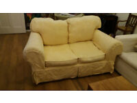 Two-seater sofa with 2 sets of washable covers