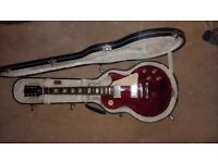Gibson Les Paul Studio Electric Guitar, Wine Red, including genuine Gibson Hard Case