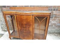 Antique display cabinet with glass side panels. 3 doors. Shelved inside. Kelvingrove park area