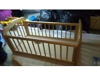 Besutiful wooden swinging crib