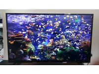 50 INCH HITACHI 4K ULTRA HD SMART TV + SUB WOOFER SPEAKER SYSTEM *PRICE NEGOTIABLE*