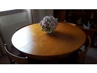 Teak dinning (extending) table and chairs. With matching sideboard.