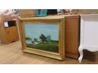 Landscape painting in chunky gold ornate frame
