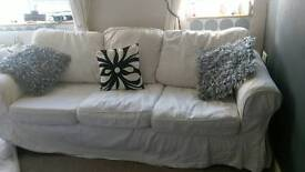Three seated white sofa